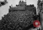 Image of Normandy beachhead filled with reinforcement troops and equipment France, 1944, second 34 stock footage video 65675072013