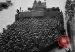 Image of Normandy beachhead filled with reinforcement troops and equipment France, 1944, second 35 stock footage video 65675072013