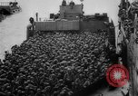 Image of Normandy beachhead filled with reinforcement troops and equipment France, 1944, second 36 stock footage video 65675072013