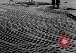 Image of Normandy beachhead filled with reinforcement troops and equipment France, 1944, second 54 stock footage video 65675072013