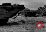 Image of Normandy beachhead filled with reinforcement troops and equipment France, 1944, second 60 stock footage video 65675072013