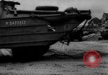 Image of Normandy beachhead filled with reinforcement troops and equipment France, 1944, second 61 stock footage video 65675072013