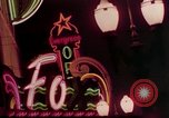 Image of neon signs of casinos and motels Las Vegas Nevada USA, 1958, second 13 stock footage video 65675072077