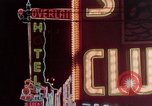 Image of neon signs of casinos and motels Las Vegas Nevada USA, 1958, second 15 stock footage video 65675072077