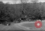 Image of Bureau of Prohibition agents destroy a whiskey distillery United States USA, 1932, second 49 stock footage video 65675072090