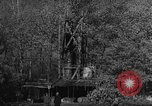 Image of Bureau of Prohibition agents destroy a whiskey distillery United States USA, 1932, second 57 stock footage video 65675072090