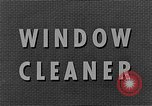 Image of window cleaner New York City USA, 1945, second 9 stock footage video 65675072164