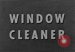 Image of window cleaner New York City USA, 1945, second 10 stock footage video 65675072164