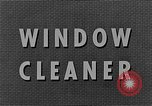 Image of window cleaner New York City USA, 1945, second 11 stock footage video 65675072164