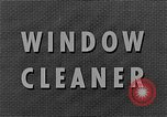 Image of window cleaner New York City USA, 1945, second 12 stock footage video 65675072164
