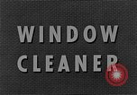 Image of window cleaner New York City USA, 1945, second 13 stock footage video 65675072164