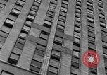 Image of window cleaner New York City USA, 1945, second 49 stock footage video 65675072164