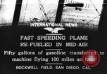 Image of mid-air refueling San Diego California USA, 1923, second 1 stock footage video 65675072184