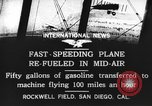 Image of mid-air refueling San Diego California USA, 1923, second 13 stock footage video 65675072184