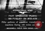 Image of mid-air refueling San Diego California USA, 1923, second 14 stock footage video 65675072184