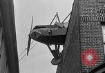 Image of landing on roof New York United States USA, 1933, second 56 stock footage video 65675072248