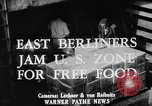 Image of Surplus food distributed for starving East Germans Germany, 1951, second 7 stock footage video 65675072259