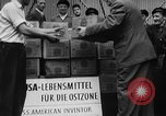 Image of Surplus food distributed for starving East Germans Germany, 1951, second 16 stock footage video 65675072259