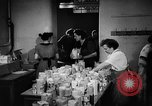 Image of Surplus food distributed for starving East Germans Germany, 1951, second 34 stock footage video 65675072259