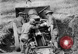 Image of United States Army artillery firing 155mm howitzers Western Front, 1917, second 47 stock footage video 65675072381