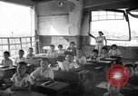 Image of school children in Hiroshima after atomic bomb Hiroshima Japan, 1946, second 3 stock footage video 65675072452