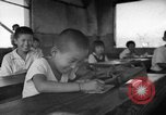 Image of school children in Hiroshima after atomic bomb Hiroshima Japan, 1946, second 29 stock footage video 65675072452