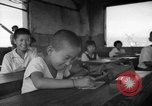Image of school children in Hiroshima after atomic bomb Hiroshima Japan, 1946, second 32 stock footage video 65675072452