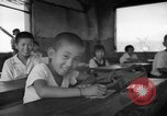 Image of school children in Hiroshima after atomic bomb Hiroshima Japan, 1946, second 33 stock footage video 65675072452