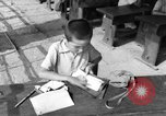 Image of school children in Hiroshima after atomic bomb Hiroshima Japan, 1946, second 50 stock footage video 65675072452