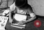 Image of school children in Hiroshima after atomic bomb Hiroshima Japan, 1946, second 59 stock footage video 65675072452