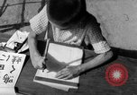 Image of school children in Hiroshima after atomic bomb Hiroshima Japan, 1946, second 60 stock footage video 65675072452