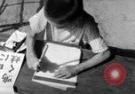 Image of school children in Hiroshima after atomic bomb Hiroshima Japan, 1946, second 62 stock footage video 65675072452