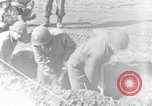 Image of American gun crew firing 105mm howitzer Germany, 1945, second 10 stock footage video 65675072467
