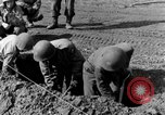 Image of American gun crew firing 105mm howitzer Germany, 1945, second 11 stock footage video 65675072467
