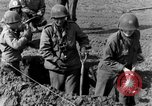 Image of American gun crew firing 105mm howitzer Germany, 1945, second 13 stock footage video 65675072467
