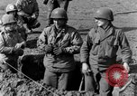 Image of American gun crew firing 105mm howitzer Germany, 1945, second 14 stock footage video 65675072467