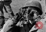 Image of American gun crew firing 105mm howitzer Germany, 1945, second 21 stock footage video 65675072467