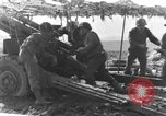 Image of American gun crew firing 105mm howitzer Germany, 1945, second 28 stock footage video 65675072467
