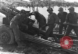 Image of American gun crew firing 105mm howitzer Germany, 1945, second 30 stock footage video 65675072467