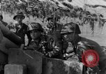 Image of American gun crew firing 105mm howitzer Germany, 1945, second 39 stock footage video 65675072467