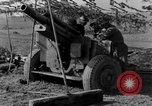 Image of American gun crew firing 105mm howitzer Germany, 1945, second 45 stock footage video 65675072467