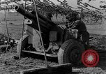 Image of American gun crew firing 105mm howitzer Germany, 1945, second 46 stock footage video 65675072467