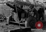 Image of American gun crew firing 105mm howitzer Germany, 1945, second 47 stock footage video 65675072467