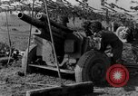 Image of American gun crew firing 105mm howitzer Germany, 1945, second 48 stock footage video 65675072467