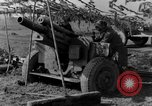 Image of American gun crew firing 105mm howitzer Germany, 1945, second 49 stock footage video 65675072467