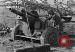 Image of American gun crew firing 105mm howitzer Germany, 1945, second 50 stock footage video 65675072467