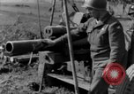 Image of American gun crew firing 105mm howitzer Germany, 1945, second 56 stock footage video 65675072467