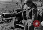 Image of American gun crew firing 105mm howitzer Germany, 1945, second 57 stock footage video 65675072467