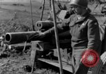 Image of American gun crew firing 105mm howitzer Germany, 1945, second 58 stock footage video 65675072467