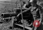 Image of American gun crew firing 105mm howitzer Germany, 1945, second 59 stock footage video 65675072467